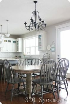 How to stain a kitchen table and chairs + a giveaway!  Hello! 5 years ago, I shared how I took our standard oak table and refinished it with a darker stain.  Well, a move across the country, years of