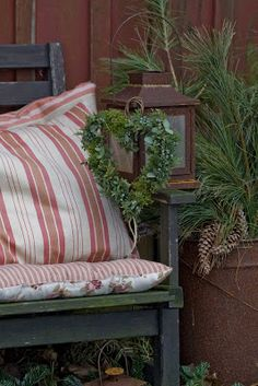 Porch setting ( red and white pillow/cushion and rusty lantern )
