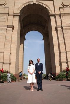 Kate Middleton and Prince William pose for photographers before paying their respects to the soldiers from Indian regiments who served in World War I, at India Gate on April 11, 2016. Kate looked radiant in a flare dress by designer Emilia Wickstead as she stands by her husband Prince William.