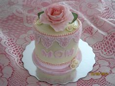 - Mini Mother's Day cake. White cake with vanilla butter cream icing and sugar rose abd decorations.