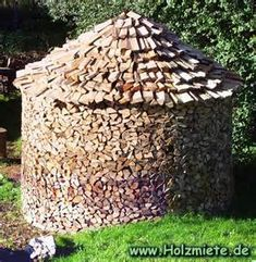 thatched roof on a holz hausen firewood stack