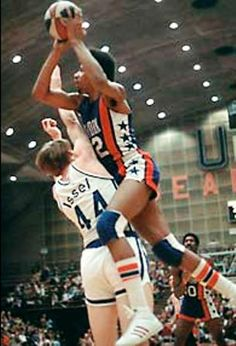 Dr. J over Dan Issel. Great vintage basketball photo!