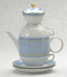 Mottahedeh's stack-able Tea for Two in Cornflower Lace (includes: tea pot, two tea cups and saucers, and a sugar bowl) decorated with 22k gold accents.