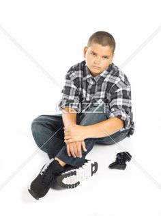 young gamer - A young gamer sitting on a white background