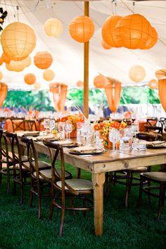 Orange paper lanterns in wedding tent