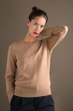 WOLFEN Germany. Knitted sweater with an ornament in front, made of lambswool.