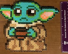 Check out our baby yoda perler selection for the very best in unique or custom, handmade pieces from our figurines & knick knacks shops. Perler Bead Templates, Diy Perler Beads, Perler Bead Art, Pearler Beads, Melty Bead Patterns, Pearler Bead Patterns, Perler Patterns, Beading Patterns, Star Wars Baby