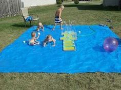 Homemade splash pad.  Use a large tarp and a hopscotch sprinkler and add water balls