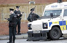 Another Northern Ireland shooting: A return to the 'Troubles?' - ON ALERT: Northern Ireland police stand guard near the scene of Monday's murder of a policeman in Craigavon, Northern Ireland. Two British soldiers were killed over the weekend. Northern Ireland Troubles, Belfast Northern Ireland, British Soldier, British Army, Irish Republican Army, Erin Go Bragh, British Government, Irish Eyes, British History