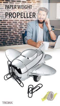 TROIKA PROPELLER. Retro aeroplane, paper weight, with magnet for paper clips, with friction motor *** Retro Flugzeug, Briefbeschwerer, mit Magnet für Büroklammern mit Rückziehmotor