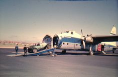 A Silver City Airways Bristol Freighter loads a Bentley aboard at Lydd Airport, Kent