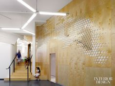 The pattern repeats as cut­outs in a plywood wall. 5468796 Architecture
