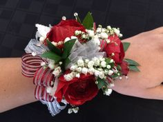 Prom Corsage. Homecoming Corsage. Red Ranunculus. Babies Breath. Striped Red Ribbon. Red and White Corsage. Red and White Flowers. Wedding Corsage. Mother of Bride. Mother of Groom. Oakleaf Florist.