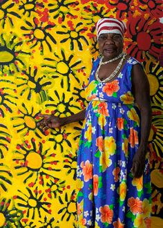 Yulyurlu 'Lorna' Fencer Napurrula with her painting Kangaroo Tucker 2004. Lorna passed away in 2006, in her eighties, just shy of a decade after the first solo exhibition of her work