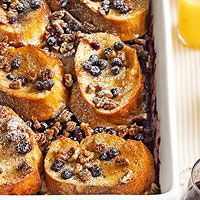 Baked Blueberry-Pecan French Toast Recipe - A gorgeous way to serve breakfast casserole-style, this French toast comes warm out of the oven with sweet blueberries and pecans atop sliced Italian bread.