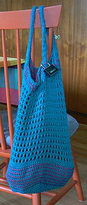 This is a market bag that has the sturdier parts done in Tunisian Crochet and the lacier parts are knit.