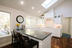 White cabinets and white appliances in kitchen makeover by Tiek Built Homes