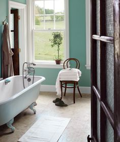 I love the non-white non-suite-y bathroom look. This looks clean but not clinical. Shame we don't get many of these airy types of rooms in the UK! More likely to have a tiny window at the top of a wall or else overlook someone elses brick wall or garden!