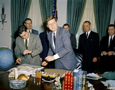 President John F. Kennedy with Press Secretary Pierre Salinger, John Connally, Secretary of Defense Robert S. McNamara, and Vice President Lyndon B. Johnson.