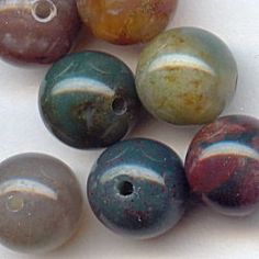 11031-8  Fancy Jasper 8mm Round Beads, 10  The deeper colors become even more scrumptious in the 8mm Fancy Jasper rounds.  They are such a compliment to New China Jade and many other gemstones.  Try coordinating some crystals into your Fancy Jasper designs. We like mocha or crystal golden shadow Swarovski crystals.