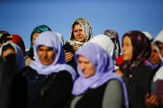 Turkish Kurdish women mourn during the funeral of Kurdish fighters killed during clashes against Islamic State in Kobani, at a cemetery in the southeastern town of Suruc, Sanliurfa province, Turkey, October 21, 2014. REUTERS-Kai Pfaffenbach