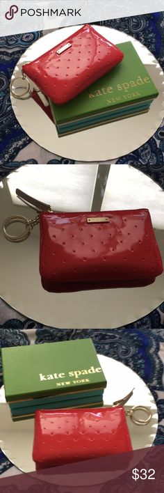 Kate Spade Larabee Dot Coin Purse/Fire Engine Red EUC Kate Spade Larabee Dot Coin Purse in Fire Engine Red. Comes with original box and tags. You'll love how easy it is to find this bright red piece in your larger bag. Clean inside and out. Smoke free. kate spade Bags Wallets