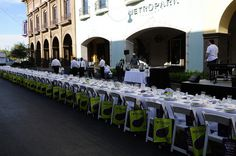 One long table, 200 guests, outdoor community event with Whole Foods reusable gift bags
