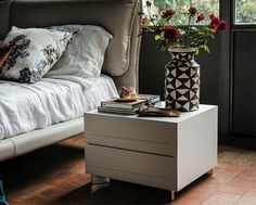 Unique two drawer nightstand presented with a frame in silver stained beech wood, Canaletto walnut, white wood or burned oak wood.