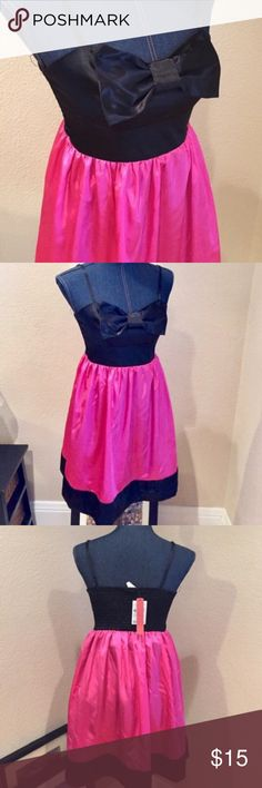 Fire Los Angeles satin pink/black bow formal dress Fire Los Angeles satin pink/black bow formal dress excellent condition brand new with tags adjustable straps and elastic upper body Fire Los Angeles Dresses