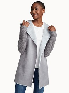 Exclusively from Twik - Trendy materials that come together to create pieces with irresistible charm - Very soft and warm faux-fur lining - Soft and light acrylic knit - Open style in front, perfect for layering - Built-in hood The model is wearing size small