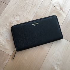 HP Kate Spade Neda Zipped Wallet Classy black leather wallet with gold hardware. Very soft leather. Zipped interior for coins plus several slots for cards. No trades. kate spade Bags Wallets
