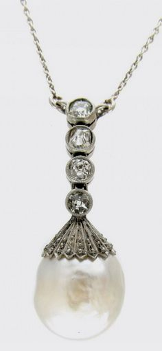 Art Deco Pearl and Diamond set drop pendant suspended on a platinum chain. Four diamonds are set above pearl pendant set in a platinum mount with a scalloped edge.