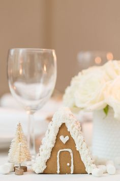 Let holiday traditions inspire your next holiday party table setting. Mini ginger bread houses are a sweet touch to your dining room table.