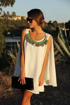 Love this but I feel like the feathers and that lime green neckline make it look a little cheap..
