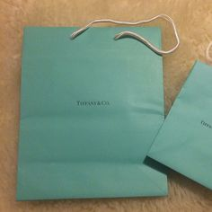 MEDIUM Tiffany & Co bag only 1 Tiffany & Co bag. Size medium. The small one sold separately! Tiffany & Co. Bags