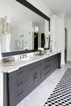 Barbara Barry Go Lightly Sconces are fixed to a full length black framed vanity mirror hung above a black dual washstand boasting shaker cabinets with bras pulls. #bathroom #mirror #ideas #bathroommirror Black Vanity Bathroom, Master Bath Vanity, Master Bath Remodel, Modern Bathroom, Small Bathroom, Bathroom Bin, Bathroom Mirrors, Gray Vanity, Remodel Bathroom