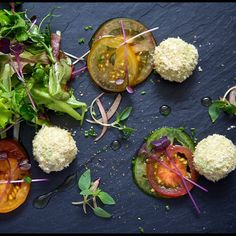 """The Raw Chef - Mozzacado Balls. """"Melon balls"""" of avocado, dipped in lemon juice, rolled in microplaned macadamia nuts."""