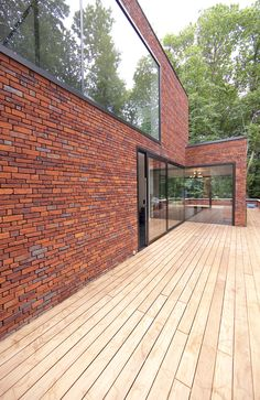 Daylight enters in various ways, abundant or filtered by leafs and bricks. Warehouse Design, Brick Construction, Brick In The Wall, Brick Texture, Brick Architecture, Brick Facade, Brick Building, Brickwork, Exposed Brick