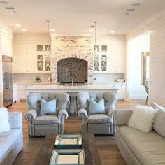 White washed brick looks exceptional in contemporary kitchens and living rooms. Farmhouse chic. Like this look? Visit us at www.realthinbrick.com