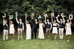Each member of your bridal party can hold up a letter or even a banner of your choosing to spell out a message as a group.Photo Credit: Brookelyn Photography