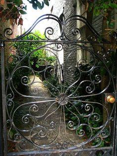 I need this gate! Iron gate entrance to secret Charleston garden. Garden Gates, Garden Art, Home And Garden, Garden Design, Door Gate, Fence Gate, Fencing, Charleston Gardens, Charleston Sc
