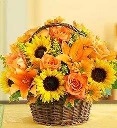 Fields of Europe™ for Fall Basket: roses, sunflowers, lilies, oak leaves and more gathered in a rustic handled basket | from 1-800-Flowers