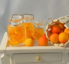 Dollhouse Miniatures - 3 Glass Jars of Homemade Peach Preserves - 1/12th scale. via Etsy.
