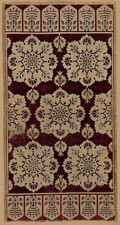 Rectangular silk velvets, such as this textile, would have been used to cover cushions, or yastik, on a low seating platform. They feature staggered rows of dramatic floral medallions set against a crimson ground
