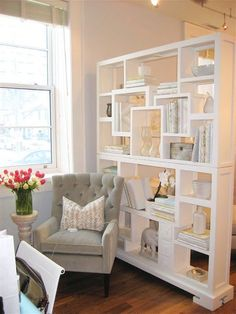 Open and airy space divide - using white shelving and white accessories really keeps the space from feeling cluttered.