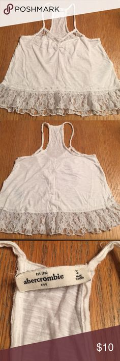 Abercrombie Girls Tank Pre owned tank top.  Tag needs to be re-seen back on.  Lace on bottom.  Very light. abercrombie kids Tops Tank Tops