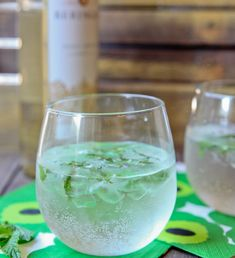 Spritzers are lighter drinks for sipping in the late afternoon on a warm day.  This version is refreshing with the addition of mint leaves!