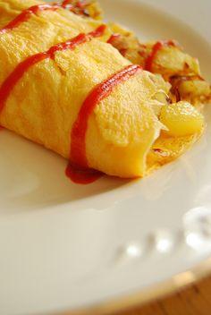 Potato Omelet with Sriracha. Breakfast.  http://www.80breakfasts.blogspot.com/2012/02/breakfast-56-potato-omelet-with.html
