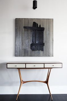 Living room decorating ideas: modern console tables to have | scandinavian console table | See more at http://homeinspirationideas.net/furnishings-inspiration-ideas/living-room-decorating-ideas-modern-console-tables-to-have
