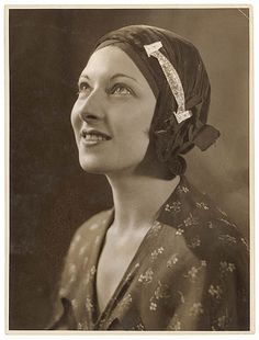 Sydney Harbour Bridge pin,on woman's hat  c. 1930s / by Sam Hood by State Library of New South Wales collection.